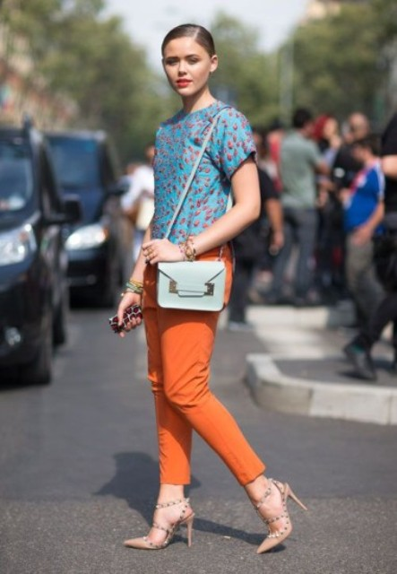 With blue printed shirt, neutral color heels and light blue bag