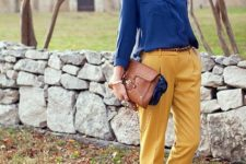 With blue shirt, brown flats and bag