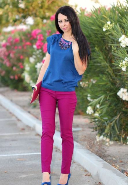 With blue shirt, necklace, fuchsia clutch and blue shoes