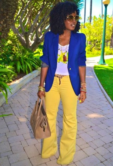 With bright blue jacket, white t-shirt and necklace