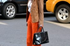 With camel jacket, white classic shirt and black leather bag