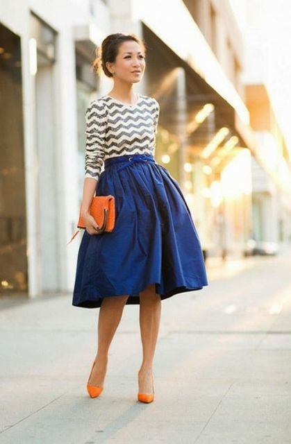 With chevron shirt, A line midi skirt and orange clutch