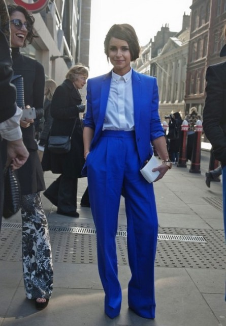 With classic button down shirt, cobalt blue jacket and mini clutch