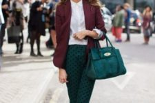 With classic white shirt, purple jacket, green bag and heels