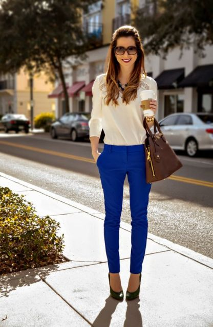 With cream blouse, black shoes and brown bag