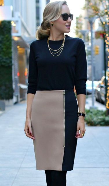 With dark color shirt and gold necklace