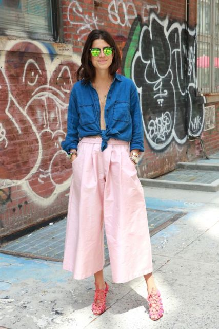 With denim shirt and pink heels
