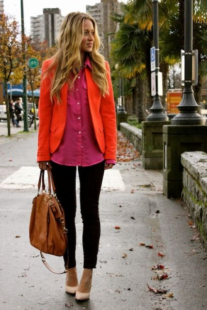 With fuchsia shirt, black skinny pants, beige shoes and brown bag
