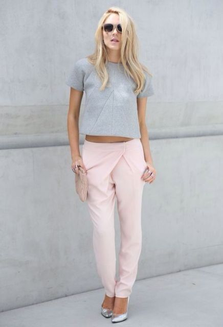 With gray crop shirt and silver shoes