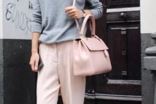 With gray pullover, wide brim hat, sneakers and light pink bag
