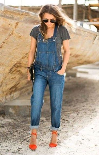 With gray t-shirt, denim jumpsuit and clutch