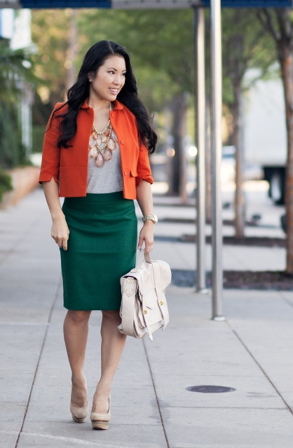 With gray top, green pencil skirt and white bag