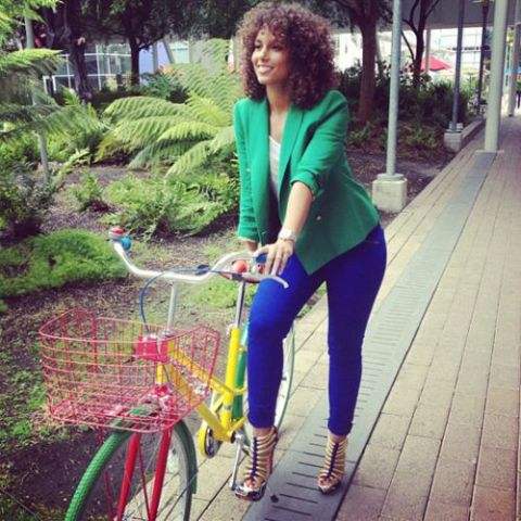 With green blazer and heels