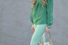 With green printed blouse, green flats and beige bag