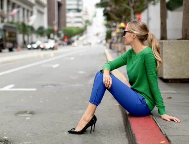 With green shirt and black pumps