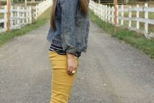 With high boots, denim jacket and striped shirt