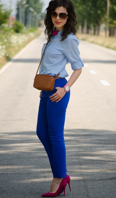 With light blue shirt, brown mini bag and fuchsia shoes