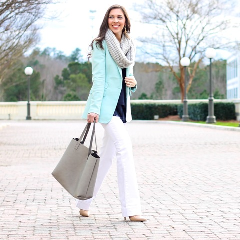 With loose blouse, white pants, gray bag and scarf