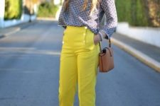 With loose printed shirt, pumps and small bag