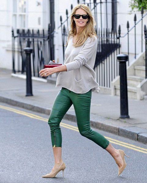 With loose shirt and neutral heels