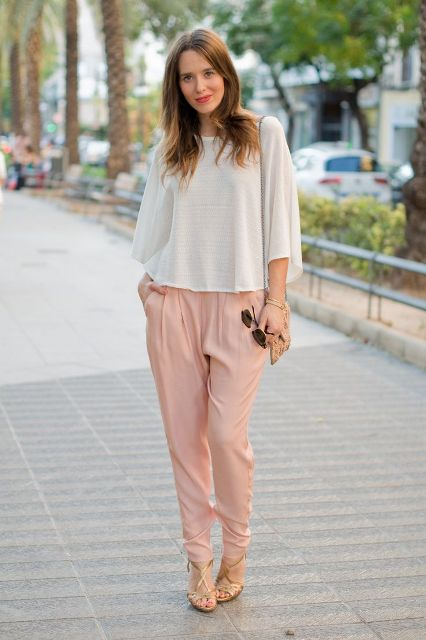 With loose shirt, heels and mini bag