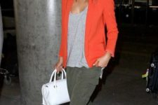 With loose top, pants, white slip on shoes and bag
