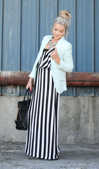 With maxi striped dress and black bag