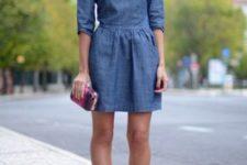 With mini denim dress and clutch