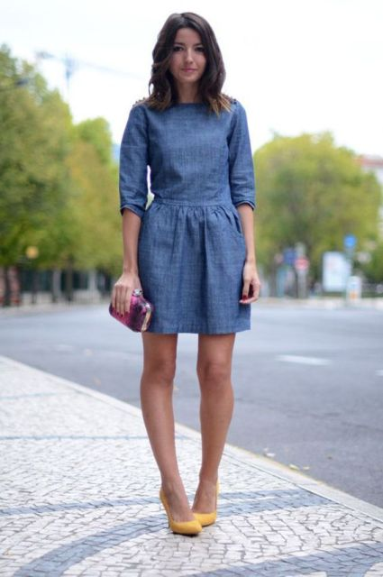 With mini denim dress and clutch