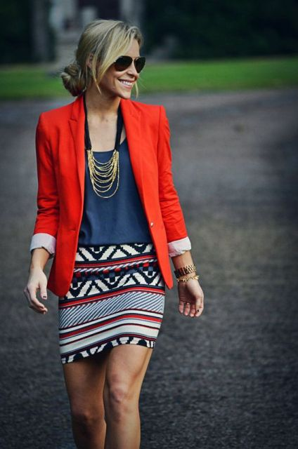 With navy blue shirt, printed skirt and necklace