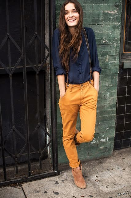 With navy blue shirt, suspenders and boots
