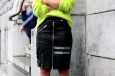 With neon sweater and metallic shoes