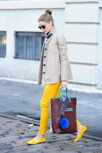With neutral mini coat, yellow loafers and unique bag