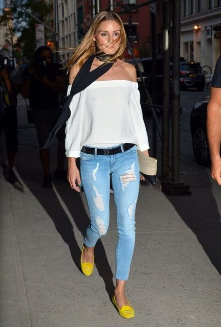 With off the shoulder blouse and distressed jeans
