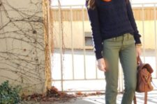 With orange scarf, sweater, olive green trousers and leather bag