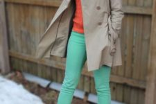 With orange sweater, beige trench coat and shoes