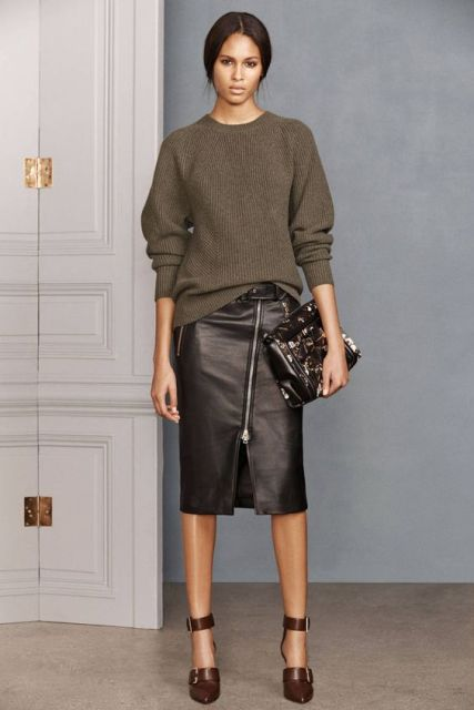 With oversized sweater, brown shoes and clutch
