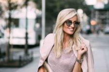 With pale pink crop shirt, jacket and metallic clutch