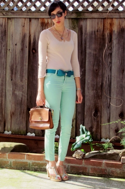 With pastel color shirt, brown bag and sandals