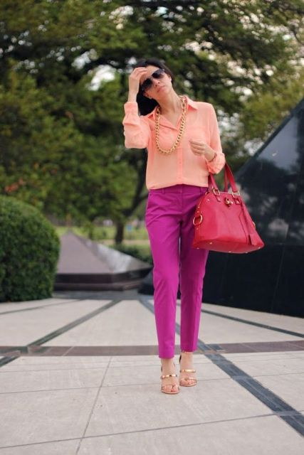 With peach blouse, pink bag and sandals