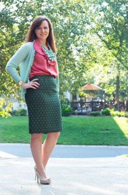 With pink blouse, emerald pencil skirt and heels