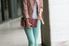 With pink jacket and clutch
