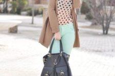With polka dot blouse, camel coat and black bag