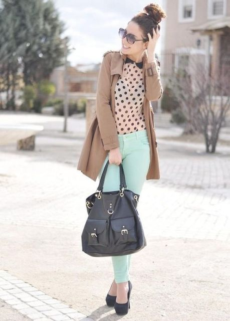 With polka dot blouse, camel coat and black bag