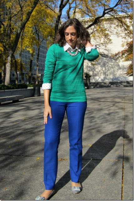 With polka dot shirt, green sweater and gray flats