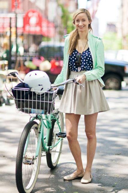 With polka dot shirt, skater skirt and beige flats