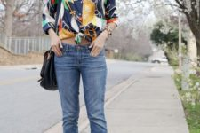 With printed shirt, cuffed jeans and black bag