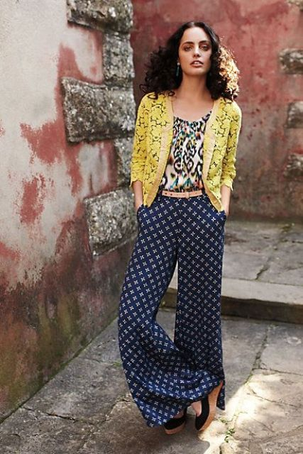 With printed shirt, yellow jacket and belt