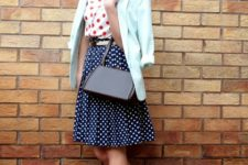 With red and white polka dot shirt, A-line skirt, red shoes and bag
