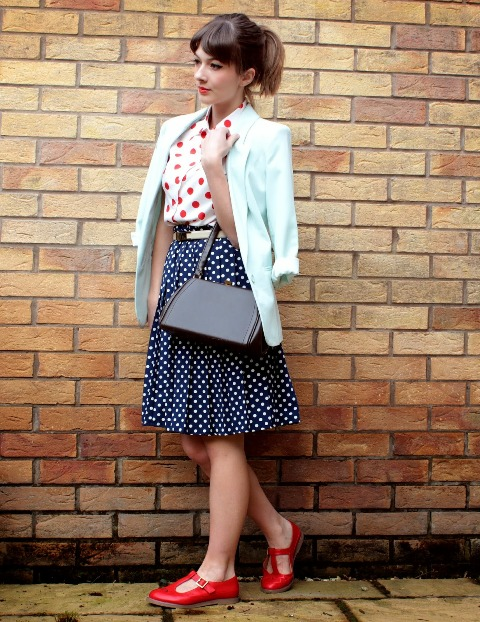 With red and white polka dot shirt, A line skirt, red shoes and bag